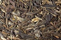 Foglie di tè di Puer in torta Immagine Stock
