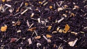 Foglie di tè giranti con l'aggiunta dell'agrume asciutto archivi video