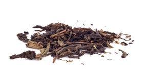 Foglie di tè nere asciutte isolate fotografie stock
