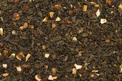 Foglie di tè verdi con struttura di frutti e dell'agrume Fotografie Stock Libere da Diritti