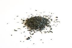 Foglie di tè verdi rovesciate Immagini Stock