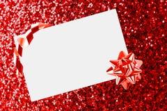 Foglio di carta di Natale con l'arco Immagini Stock