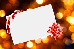 Foglio di carta di Natale con l'arco Fotografia Stock Libera da Diritti