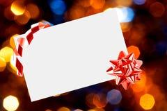 Foglio di carta di Natale con l'arco Fotografie Stock