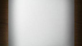 Foglio di carta su un di legno Fotografia Stock