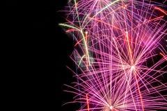 Fogo de artifício do ano novo no fundo escuro Fotos de Stock
