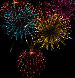 Fogo de artifício abstrato festivo que estoura em vário Imagens de Stock