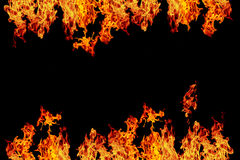 fogo ou chama em chamas do amarelo, o alaranjado e o vermelho e o vermelho do fogo da parede, mim Fotografia de Stock