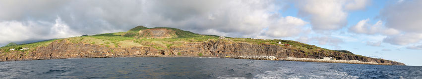 Fogo and it's shipping port. The sole shipping port of Vale dos Cavaleiros as seen from a departing boat on the island of Fogo, Cabo Verde royalty free stock photos
