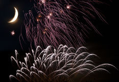 Fogos-de-artifício com a lua no céu fotografia de stock royalty free