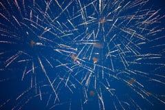 Fogos-de-artifício no céu azul fotografia de stock royalty free