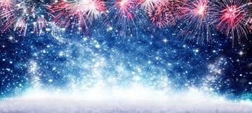 Fogos de artifício, véspera nova de Year#s do fundo azul fotografia de stock royalty free