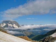 Fogs and clouds. Caucasian mountain, Karachay-Cherkessia,  Arkhyz area, the middle of summer Stock Photos