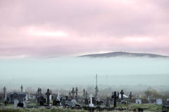 Fogy Ballybunion graveyard. Fog rolling into the graveyard next to Ballybunion golf course in county Kerry Ireland Royalty Free Stock Photo