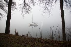 Fogy lake, parking sail-ship, winter landscape Royalty Free Stock Image