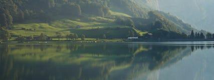 Fogy morning at lake Klontalersee Switzerland. Royalty Free Stock Photo