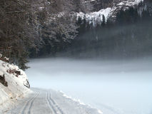 Fogy snow. Fog over frozen lake in the French alps winter Stock Photography