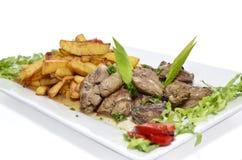 Foie et pommes de terre de poulet Photographie stock
