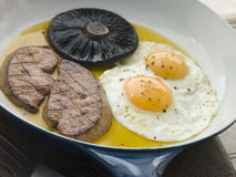 Foie Gras Eggs and Portabello Mushrooms Stock Image