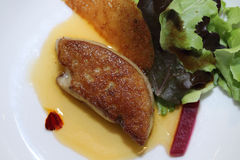 Foie gras with jam on the plate Royalty Free Stock Image