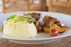 Foie Gras with Mashed Potatoes and Fruits. Foie Gras with Mashed Potatoes Stock Photography