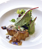 Foie gras med sallad royaltyfri bild
