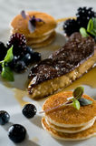 Foie gras with mini pancakes Royalty Free Stock Image