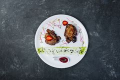 Foie Gras On Medallions Of Veal With Sweet Eggplants. Royalty Free Stock Photos