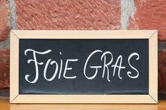 Foie gras på en svart tavla royaltyfria bilder