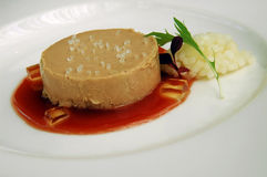 Foie Gras patte. Over tomato sauce Royalty Free Stock Image