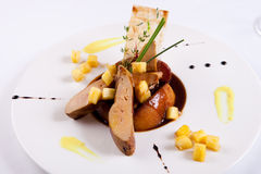 Foie gras with pineapple. Roasted Foie gras with pineapples Stock Photo
