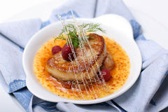 Foie gras with raspberries syrup. Stock Image
