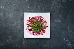 Foie gras salad with wild berry sauce. stock photo