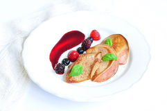 Foie gras with a sauce from berries Royalty Free Stock Photos