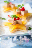 Foie gras on star-shaped toasts. Foie gras and orange aspic on star-shaped toasts Stock Photography