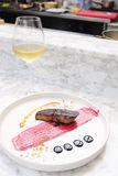 Foie Gras steak with red berry sauce and white wine Stock Photo