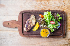 Foie gras steak with vegetable and sweet sauce Stock Image