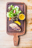 Foie gras steak with vegetable and sweet sauce Royalty Free Stock Images