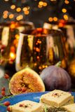 Foie gras on wholewheat bread. With juicy ripe figs served as snacks at a festive celebration with colorful party lights in the background Stock Image