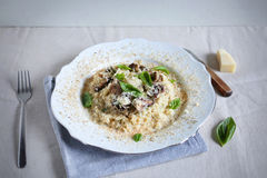 Foie gras and wild mushroom risotto with parmesan and basil Stock Images