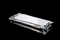 Foil aluminum bag closed isolated on black Royalty Free Stock Images