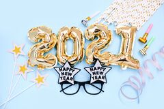 Free Foil Balloons In The Form Of Numbers 2021 And Festive Glasses On Blue Background. New Year Party Decoration. Top View Royalty Free Stock Image - 204107346