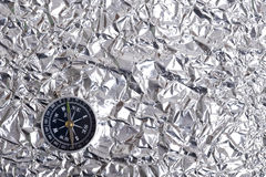 Foil and compas. Aluminum Foil abd compas.Creative metallic texture royalty free stock images