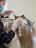 Foil on the hair when coloring the hair. royalty free stock photos