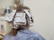 Foil on the hair when coloring the hair. royalty free stock photo
