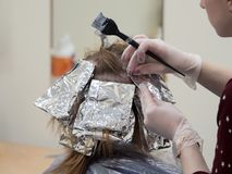 Foil on the hair when coloring the hair. royalty free stock photography