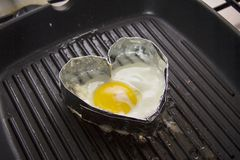 Foil heart f form with egg inside 3/4 Stock Image