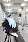 Foil, mask and glove at background ot fencer Stock Images