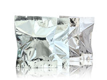 Foil package. On reflect floor and white background Stock Photos
