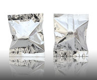 Foil package. On reflect floor and white background Royalty Free Stock Photo